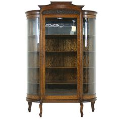 Antique American Tiger Oak Bow Front China, Display, Curio Cabinet | From a unique collection of antique and modern cabinets at https://www.1stdibs.com/furniture/storage-case-pieces/cabinets/