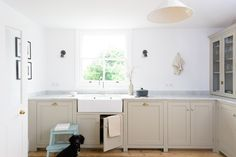 A beautiful Shaker Kitchen by deVOL and a cute little puppy