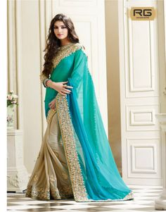 Blue Gold Embroidered Saree    Look stunning in this beige color shimmer saree that has gold floral embroidered buttas and border work on bottom.    RG Designers