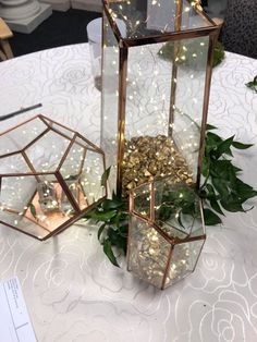 Wedding decor, terrariums, string lights, fairy lights, table centerpieces #weddingdecoration