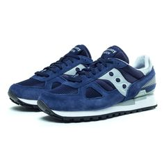 The iconic Saucony Shadow Original, shown here in navy suede, purple mesh and grey rubber detailing, is a lightweight retro classic runner that features a soft EVA midsole to absorb shock and a black triangular tread rubber sole. Padded collar and tongue delivers a comfy fit. Fabric lining and a cushioned EVA sockliner for all-day comfort. Traditional lace up front provides optimum fit. EVA midsole cushions and absorbs shock. http://www.zocko.com/z/JFglm