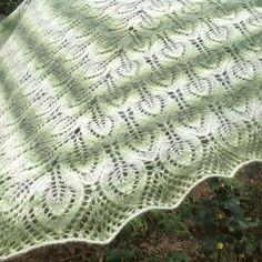 A personal favourite from my Etsy shop https://www.etsy.com/listing/465485070/triangle-shawl-handknitgreen-and-cream