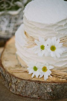Rustic wedding cake, Maybe use the cosmos? or the small sunflowers in place of the white daisys
