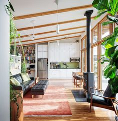 This modern studio dwelling with 704 sq ft, all on a single level, was designed and built by the owners.