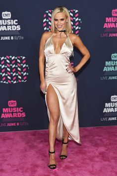 WORST: WWE Superstar Lana donned a tacky satin-like champagne gown with cheap-loking ruching. (Photo by Mike Coppola/Getty Images for CMT)  via @AOL_Lifestyle Read more: http://www.aol.com/article/2016/06/09/viewers-unimpressed-by-the-lack-of-country-music-at-the-cmt-awar/21392229/?a_dgi=aolshare_pinterest#fullscreen