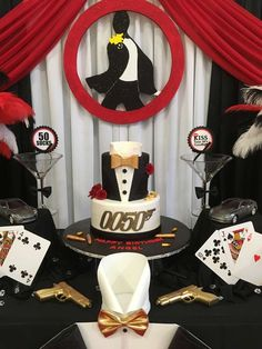 Home · casino party ideas; how to host the best casino royale party. see more fun ideas for a james bond theme party at. James Bond Party, James Bond Theme, James Bond Cake, Casino Night Party, Casino Theme Parties, Adult Party Themes, Casino Decorations, 50th Birthday Party, Cake Birthday