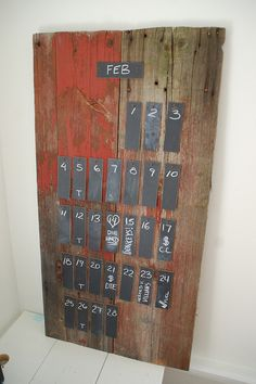 """""""rustic"""" DIY calendar using old boards and chalkboard paint chips."""