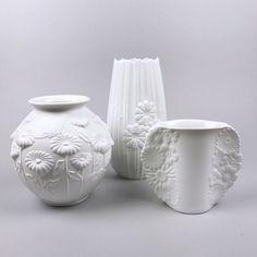 Matte white German Kaiser porcelain vases.