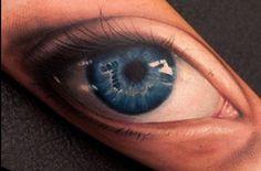 Realistic blue eye tattoo on arm