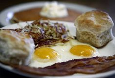 The Pancake Shop's Everyday Special with two cooked-to-perfection eggs, crispy bacon, hash browns, biscuits and pancakes. (Mark Weber, The Commercial Appeal)