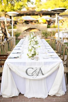 Gorgeous table with monogramming: http://www.stylemepretty.com/california-weddings/yountville/2015/06/02/rustic-romantic-napa-valley-wedding/ | Photography: Brooke Beasley - http://brookebeasleyphotography.com/