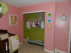 Pink walls and green closet in baby girl nursery