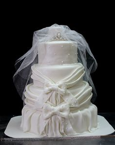 Gorgeous white wedding cake by The House of Cakes Dubai, via Wedding Cake Queen
