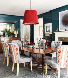 In a Nashville house renovated by designer Markham Roberts, an overscale lampshade covered in Schumacher's Sargent silk taffeta proves that an antiques-filled dining room doesn't have to feel formal. Pierre Frey's Mauresque adds an exotic touch to the backs of dining chairs upholstered in Michael S. Smith's Gavle from Jasper.   - HouseBeautiful.com