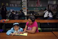 Eriselda Hernandez, right, reads with Fernanda Arana, 6, before school begins at Washington Elementary School in San Jose, Calif. The school's weekly Madre a Madre meetings help bring parents into the school regularly to support children's literacy development.