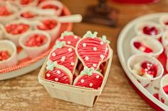 strawberry cookies in a wooden berry basket
