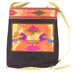 """Elegant Black Color Pure Silk CrossBody Sling Handbag with Handwoven Zari Brocade Colorful Peacocks and Motifs. Made with 100% Authentic Paithani Silk. For more information on paithani sarees please visit https://en.m.wikipedia.org/wiki/Paithani All of our handbags are made in Yeola, India.  Handbag Details:  *Color: Black  *Type: Cross Body Sling *Material: Silk *Dimensions: 9'' L x 7"""" W  Care instructions: DRY CLEAN ONLY. No twisting or wringing. DO NOT BLEACH. DO NOT IRON."""