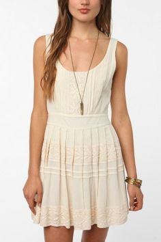 PLEASE DESCRIBE YOUR PIN .. um ok     this pin is about a girl wearing an off white sun dress which i appreciate the visuals of because of the delicate pattern and pleating on the skirt and lightly structured waistline.