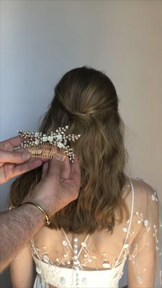 This elegant half updo style used the Perla Bobby Pins and the Persephone Comb both available on our website: www.jenniferbehr.com
