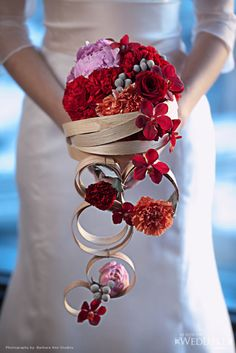 Modern Wedding Bouquet with red flowers and balsam wood spirals