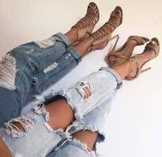 Matching ripped jeans and matching nude heels.