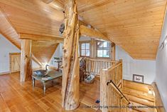 Loft area with Western Red Cedar Character Log Post in Custom Red Cedar Log Cabin Home Home Developers, Cedar Log, Cedar Homes, Timber Frame Homes, Log Cabin Homes, Post And Beam, Western Red Cedar, Beams, Building A House