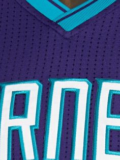 NECKLINE · The crossover V-neck is a carryover from the original Hornets uniform · Striping goes to the point of the V