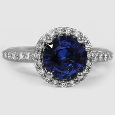 Platinum Sapphire Halo Diamond Ring with Side Stones // Set with a 7.5mm Blue Round Sapphire #BrilliantEarth