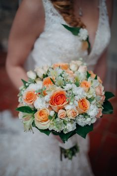 Orange and white wedding flowers at Bolinbroke Mansion in Philadelphia by Juliana Laury Photography