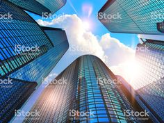 Downtown corporate business district architecture concept: render illustration of the glass reflective office buildings skyscrapers against blue sky with clouds and sun light , Creative Architecture, Architecture Student, Concept Architecture, Facade Architecture, Residential Architecture, Amazing Architecture, Corporate Office Design, Corporate Business, Exposed Ceilings