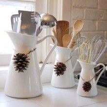 love the idea of water jugs as utensil caddies (minus the pine cones)
