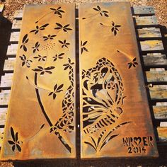 Double panel featuring dandelion and butterflies. Handcut in 3mm corten steel using a plasma cutter