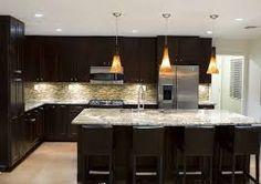 Risultati immagini per luci su isola cucina