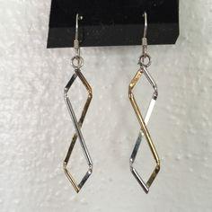 """SILVER & GOLD Twisted Dangle Earrings Never wornSILVER & GOLD Twisted Dangle Earrings.  Silver and gold colored earrings.  2"""" x 3/8"""". Jewelry Earrings"""