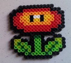 Fire Flower Perler Bead Sprite by LaurelxDesigns on Etsy, $3.00