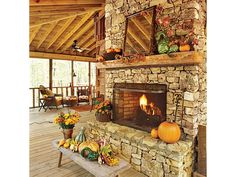 Autumnal fireplace An outdoor fireplace makes it comfortable to sit outside on cool fall evenings. Touches of the season around the mantel and the hearth feature arrangements of pumpkins, gourds and fall leaves. Must have giant outdoor living space! Outdoor Rooms, Outdoor Living, Indoor Outdoor, Outdoor Patios, Outdoor Kitchens, Mesa Exterior, Fall Mantel Decorations, Mantel Ideas, Outdoor Decorations