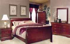 Love the color scheme here, as well as the sleigh bed.