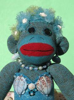 Mermaid Sock Monkey. I love her <3...my girls need these!!