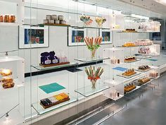 Decorative / Product Glass Shelving Suspended on Cable System (Market Café at ATT Center)