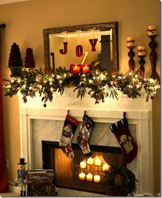 I am SOOOOgoing to do this one for my front room mantle this year!!! Christmas mantel with DIY JOY letters
