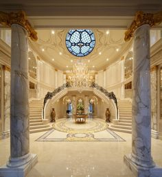 This grand staircase is located in a 36,000 square foot mega mansion in Beverly Hills, CA. It has been featured in numerous movies and television shows such as In Time with Justin Timberlake and The Good Place with Kristen Bell.