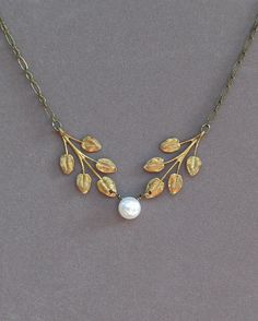 Necklace . Vintage Patina Brass Leaf Branch . White Fresh water Pearl . Jewelry By envisage. $29.00, via Etsy.