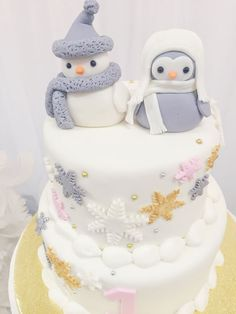"""Winter """"ONE-derland"""" 1st birthday cake with adorable penguins! See the entire Winter Wonderland Party on www.prettymyparty.com."""