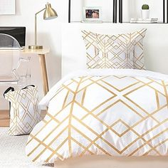 Bold and fun, the Elisabeth Fredriksson Golden Geo Duvet Cover Set from DENY Designs brings a playful flair to your bedroom style. Boasting a bold metallic geometric print along a crisp white ground, the set will transform your space with modern style.