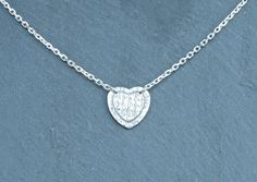 Heart Necklace fine silver by MeltSilver on Etsy This fine silver heart necklace has been handmade by me, and would make an ideal gift for someone special, or just a perfect present to yourself! Because of the processes involved in making this piece, you can be sure that you are getting a real one-off - no two pieces will ever be the same!
