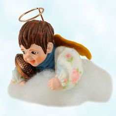 Simpich's Cloud Baby angel Christmas ornament plays football in a high, high cloud!