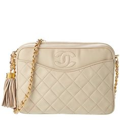 Cream Crossbody Camera Bag | CHANEL Vintage from 1990s. Includes authenticity card and dust bag. 100% authentic. In used condition but has many years of life left. Edges are in slightly rough shape. This bag would do well at the Chanel shop where they can restore it to its original condition. Cream patent leather with gold accents. Open to offers. Lighting in my apartment isn't great. Color is cream/beige. CHANEL Bags Crossbody Bags