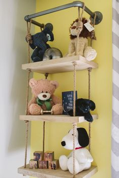 Wood Shelves Hanging from Rope {from @rhbabyandchild} - Fab way to display sweet keepsakes in the nursery!