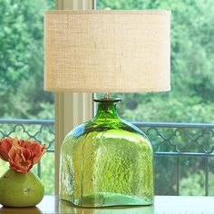 Apothecary Glass Jug Table Lamp. I bet there's something here on how to make a lamp like this