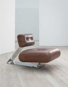 OSCAR NIEMEYER Rare 'Aran' lounge chair, c. 1975  Leather, stainless steel. 76.2 cm. (30 in.) high Produced by Aran Line, Italy.  Top of foot cast with 'Oscar Niemeyer' and manufacturer's logo.
